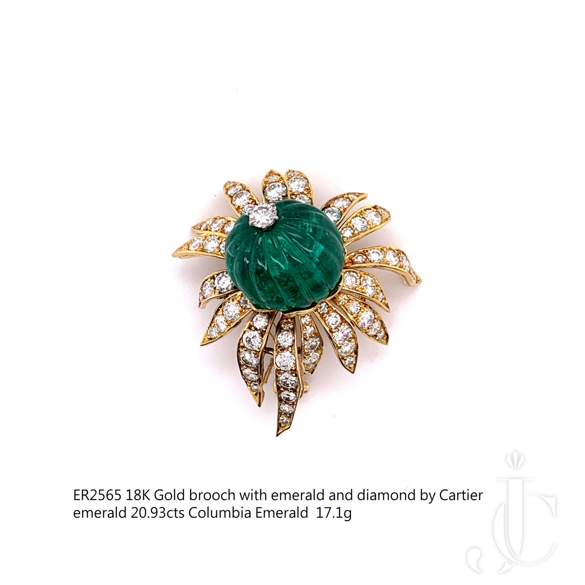 18k gold brooch with emerald and diamond by Cartier