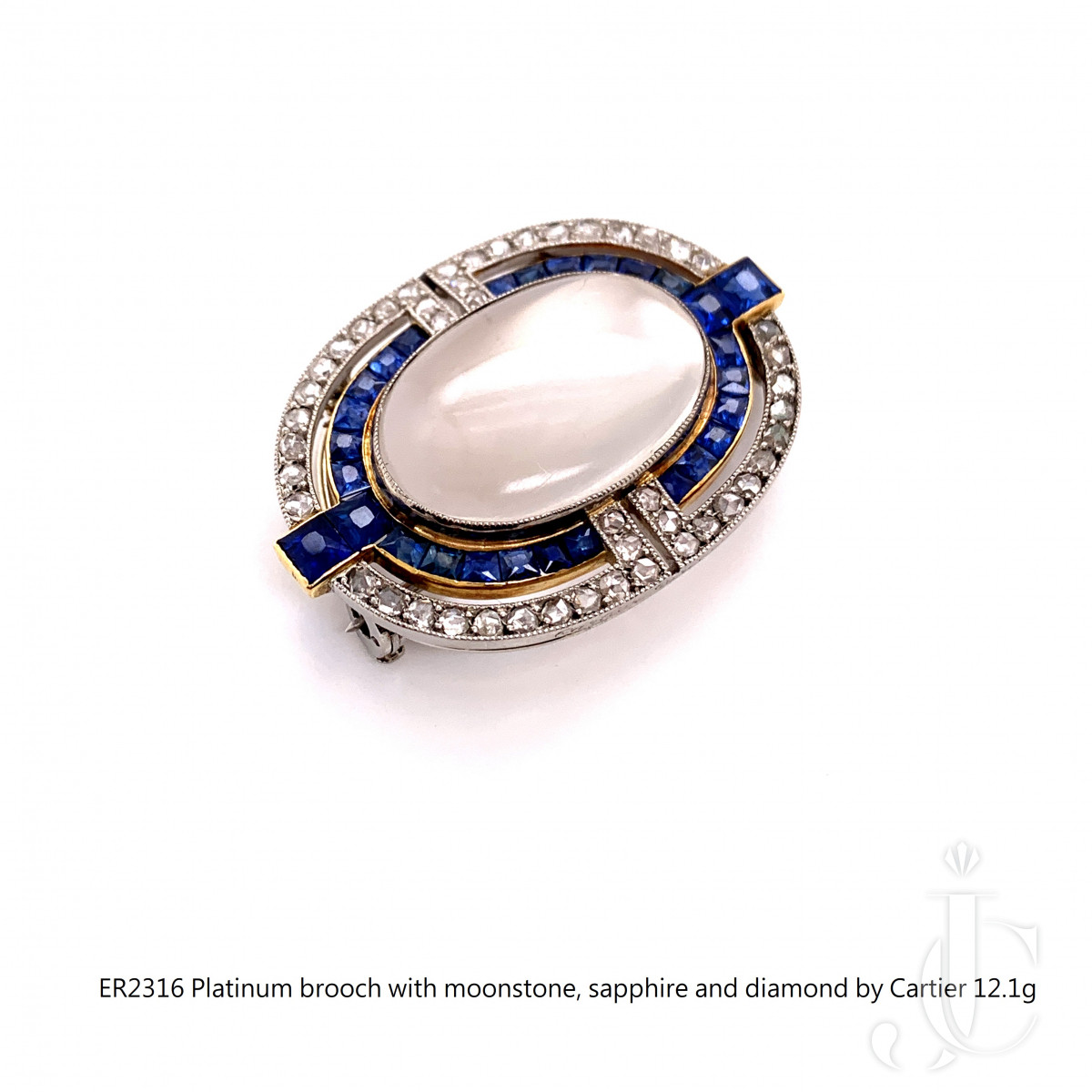Platinum brooch with moonstone, sapphire and diamond by Cartier