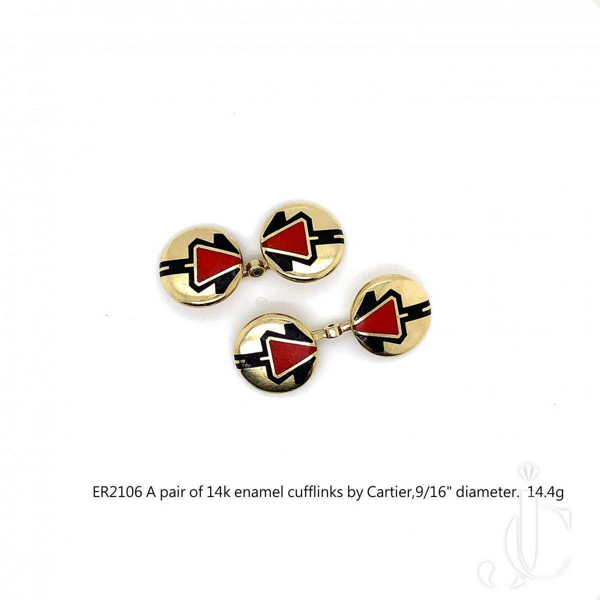A pair of 14k enamel cufflinks by Cartier,916 diameter.