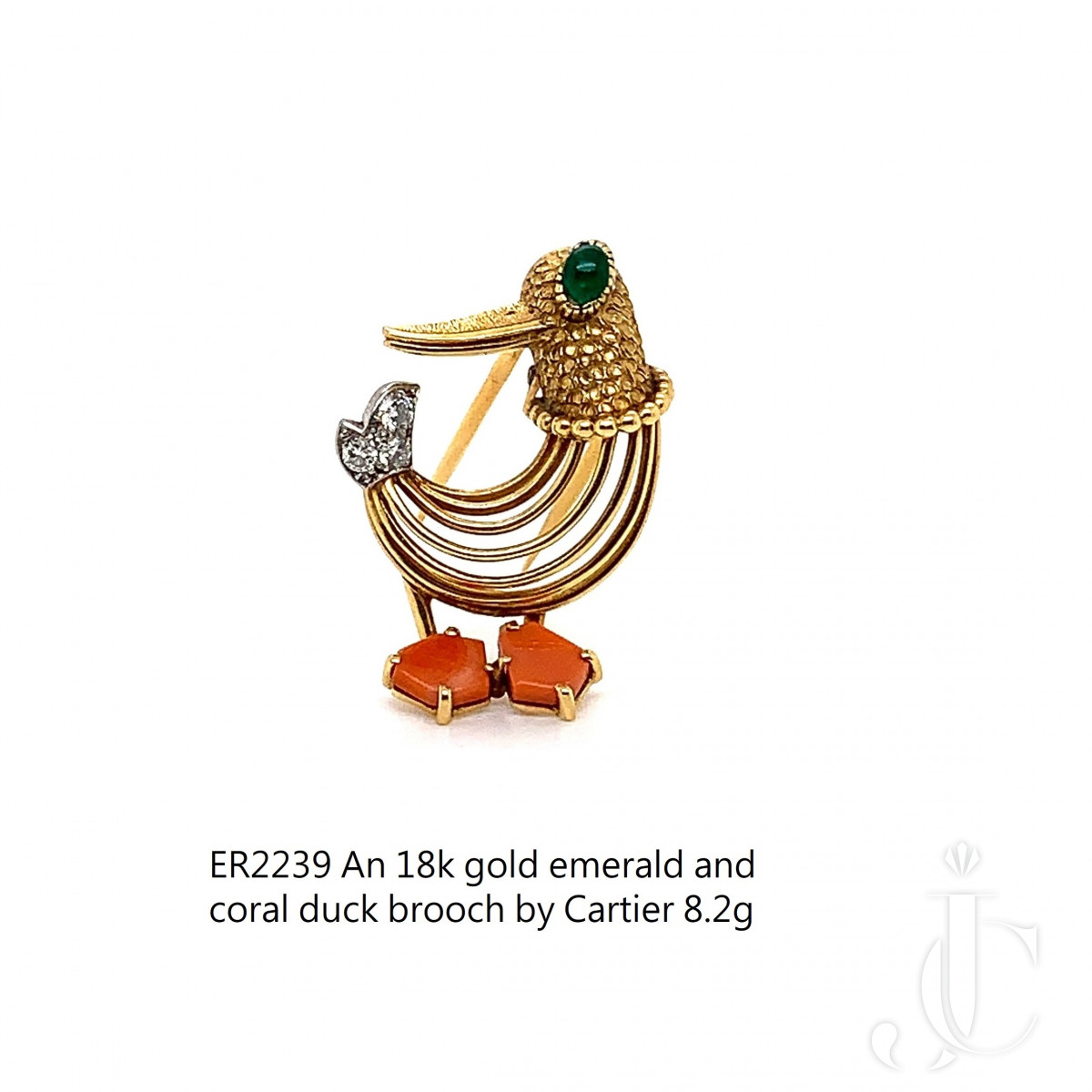 An 18k gold emerald and coral duck brooch by Cartier