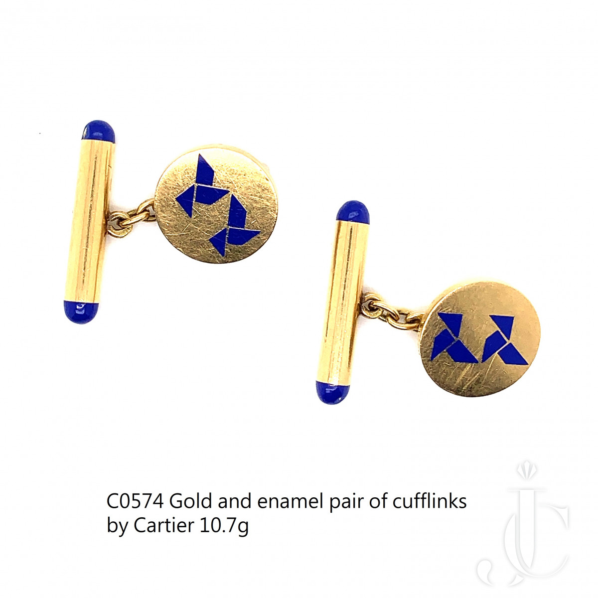 A pair of 18k Gold and ename cufflinks by Cartier