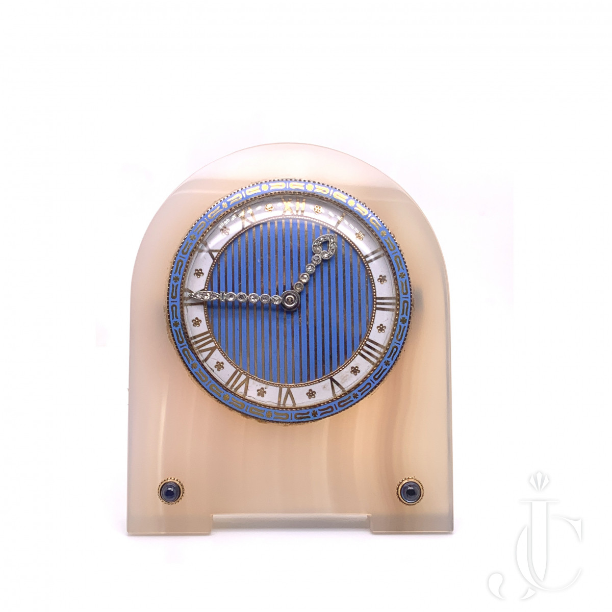 An 18k gold and silver, agate, enamel, sapphire and diamond clocks by Cartier