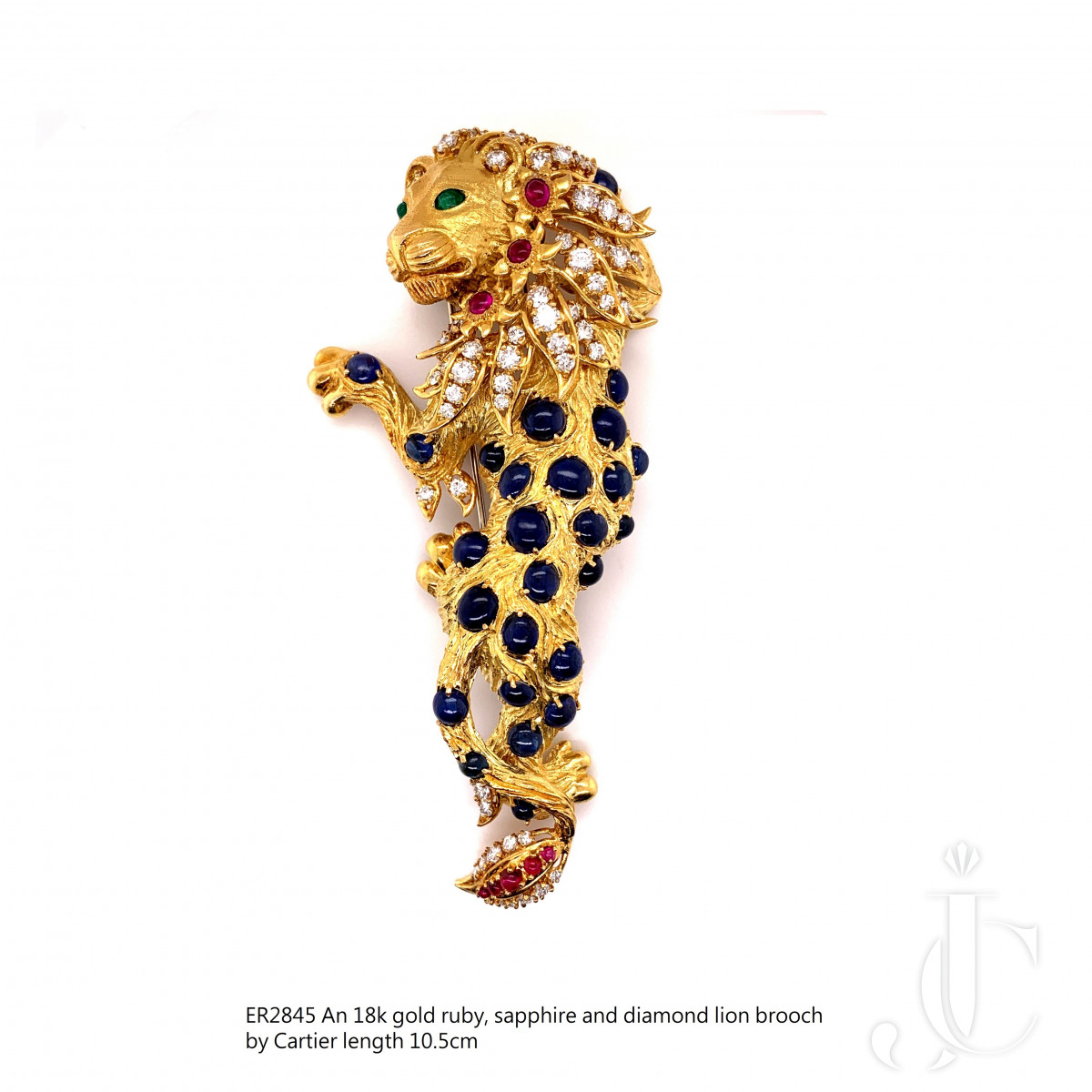 An 18k gold sapphire, ruby , emerald and enamel lion brooch by Cartier