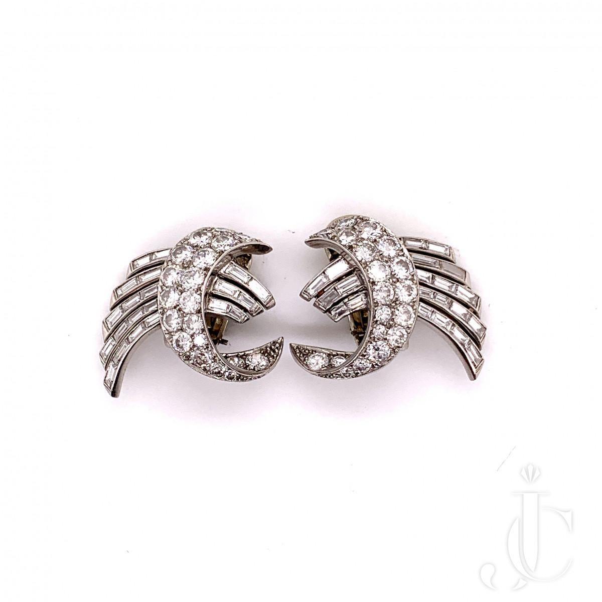 Platinum,  gold diamond earring by Marc Paris
