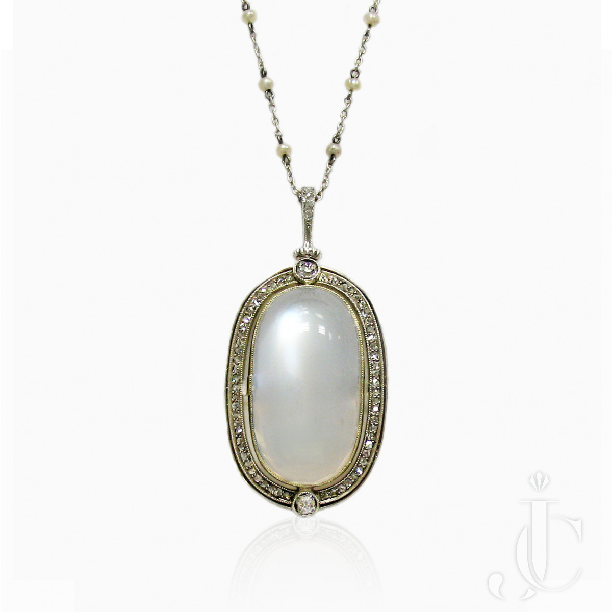 Antique Silver and Yellow Gold Moonstone and Diamond Pendant