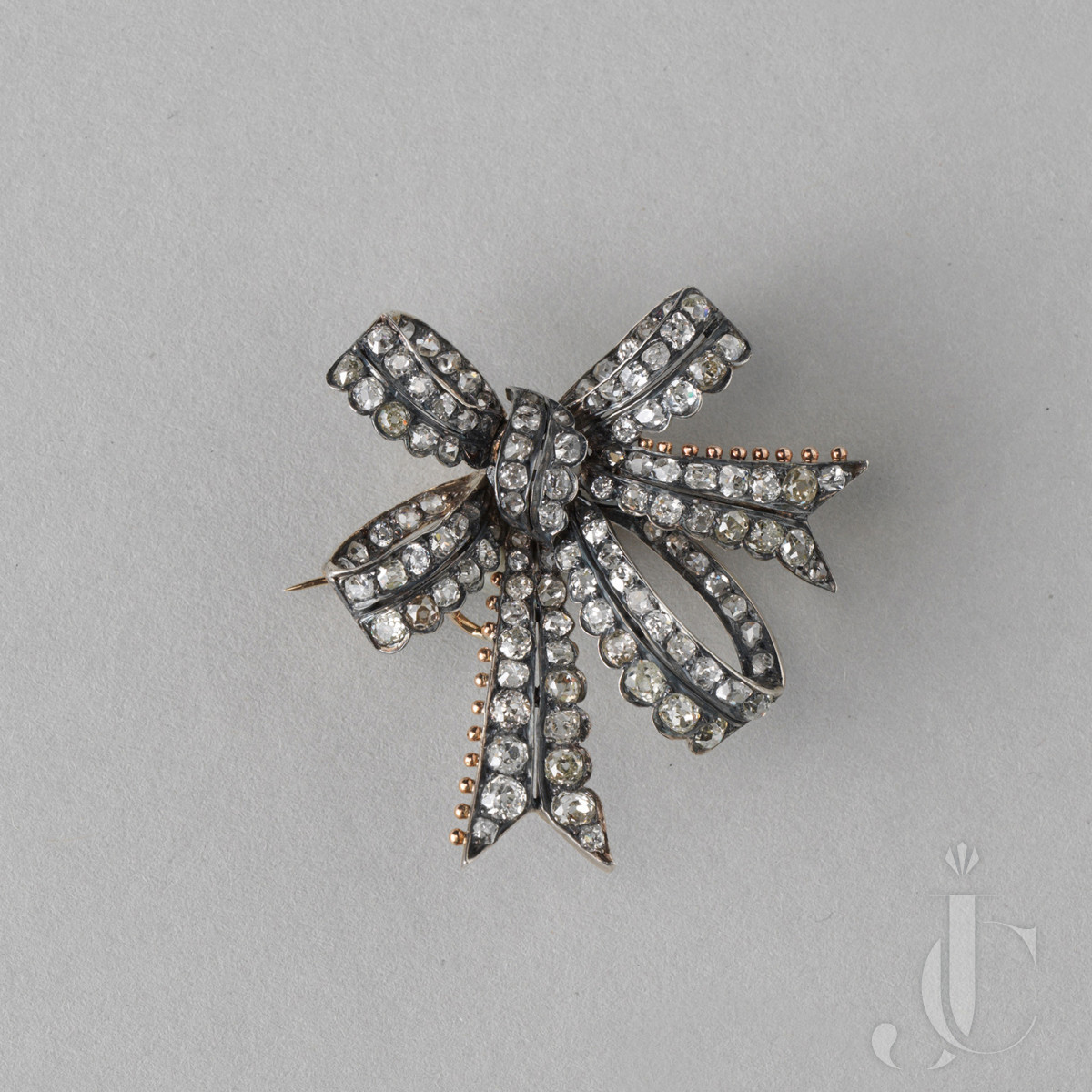 DIAMOND AND GOLD BOW BROOCH