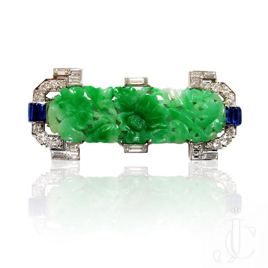Platinum Art Deco Carved Jade, Sapphires and Diamonds Brooch, Mauboussin - Paris, circa 1930