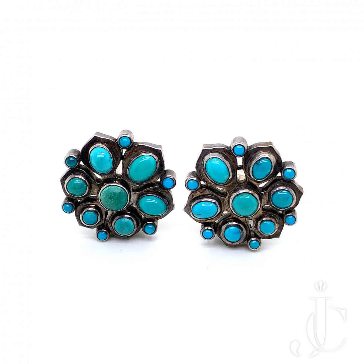 A pair of turquoise silver earrings by Rene Boivin