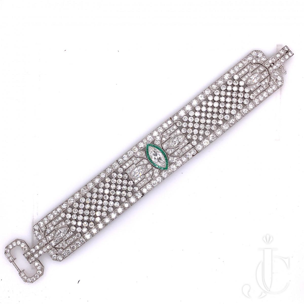 A platinum diamond and emerald bracelet