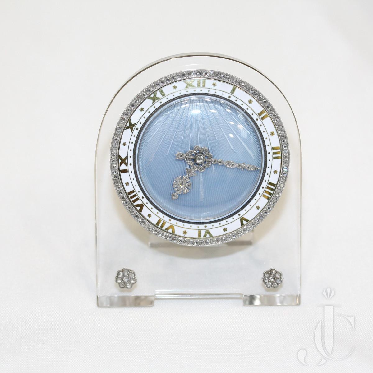 A rock crystal blue enamel clock by Cartier