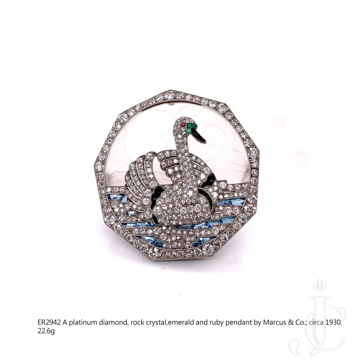 A platinum diamond, rock crystal,emerald and ruby pendant by Marcus & Co.