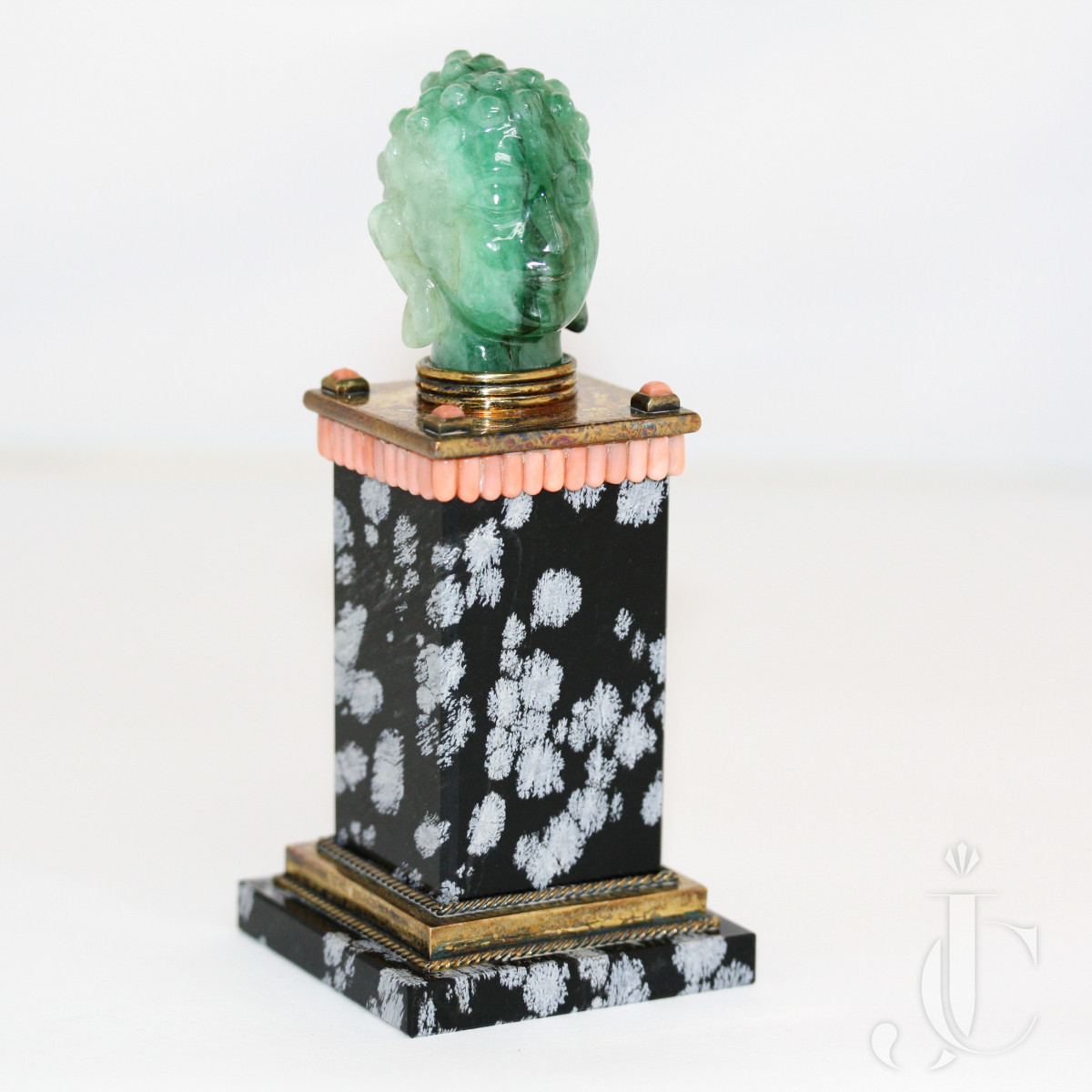French gold emerald Buddha head and obsidian, coral column stand sculpture