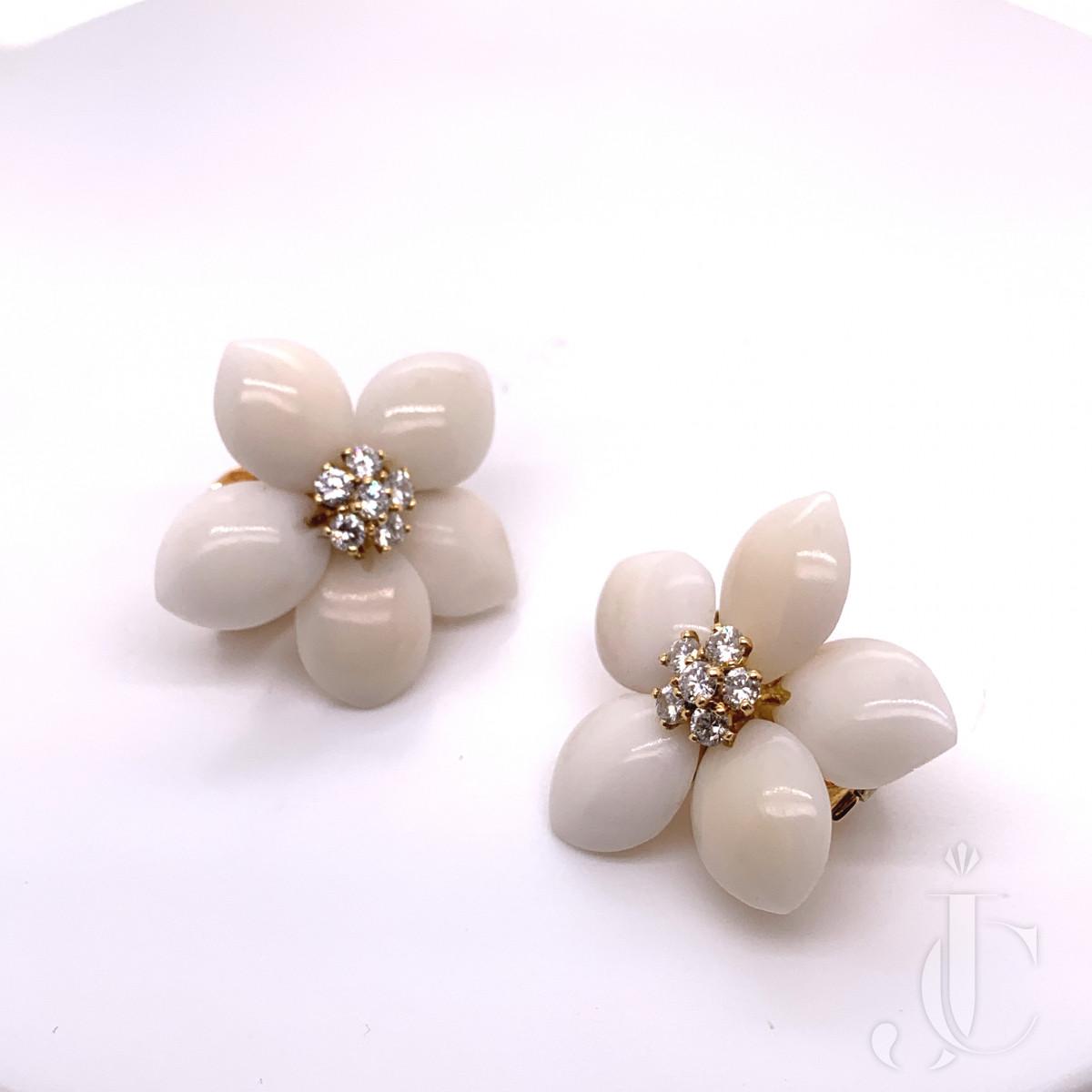 """A pair of coral and diamond """"Rose de noel"""" flower ear clips by Van Cleef & Arpels"""