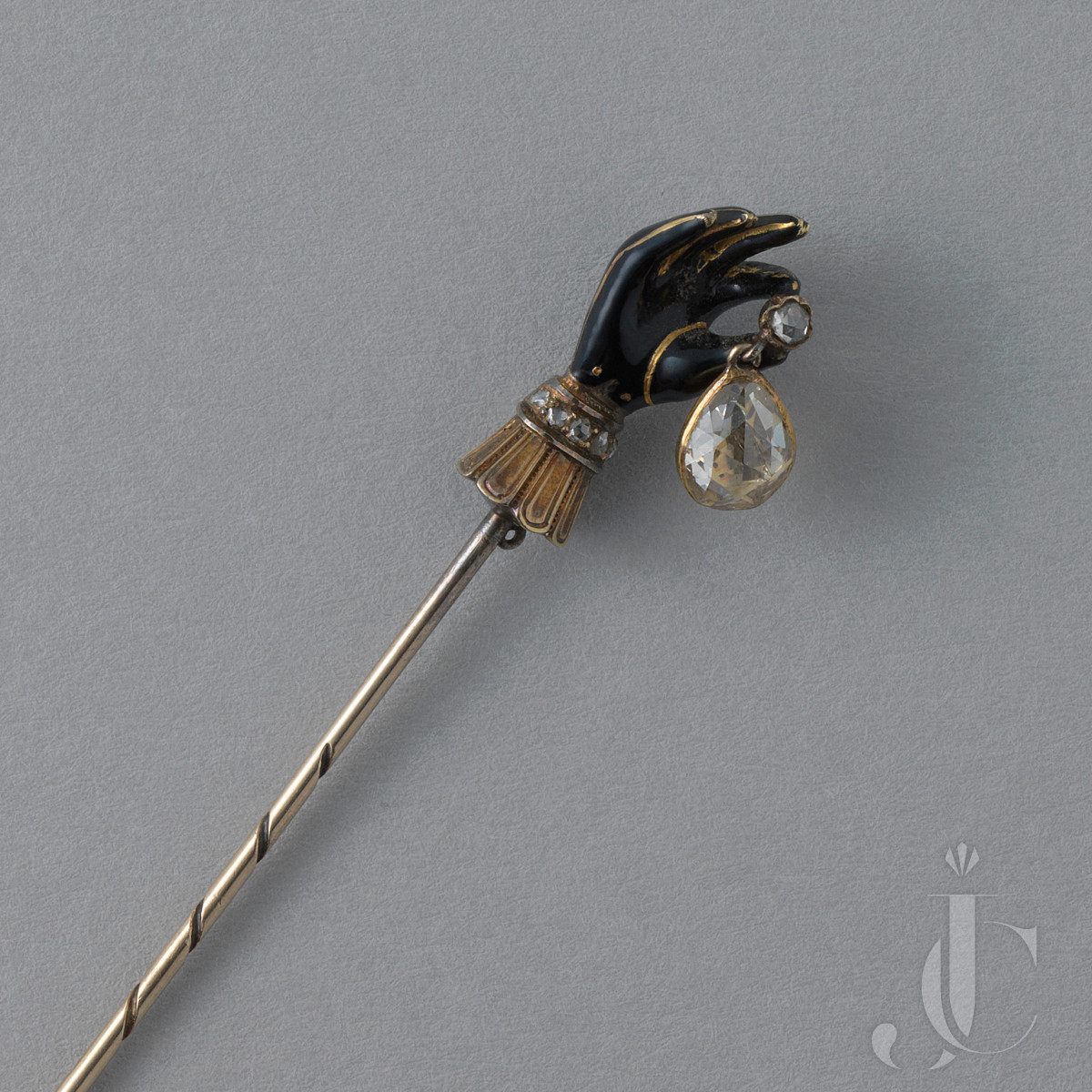 GOLD AND SILVER GLOVED HAND PIN