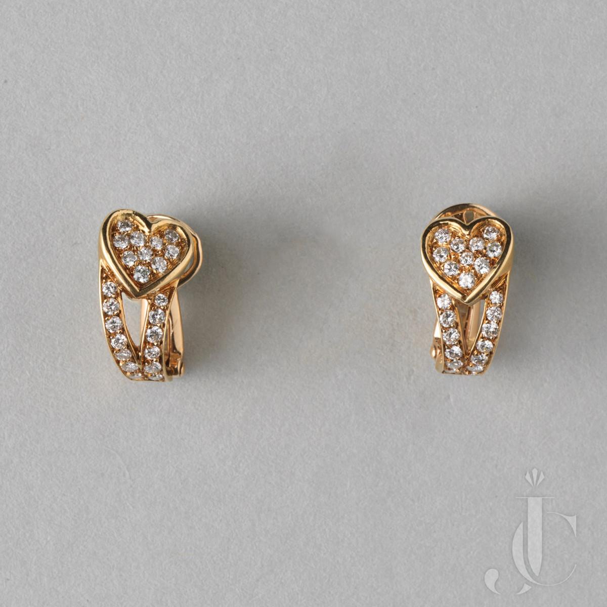 An 18 CARAT GOLD AND DIAMOND BOUCHERON HEART EAR CLIPS