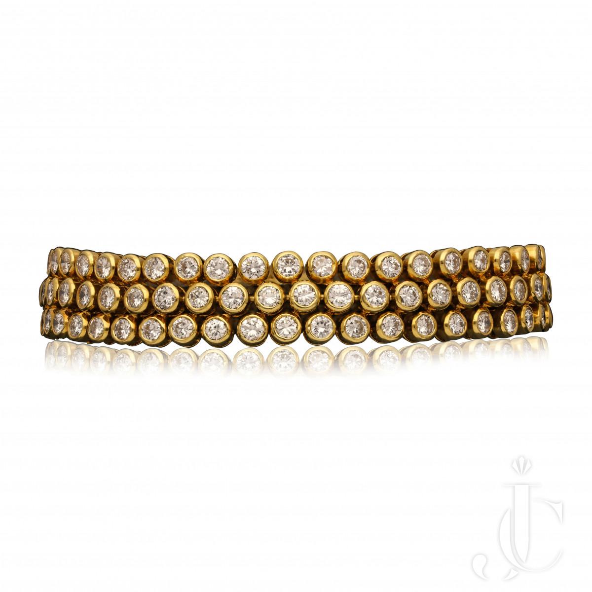 Cartier, Paris - Very Flexible 18ct yg diamond bracelet c.1970s