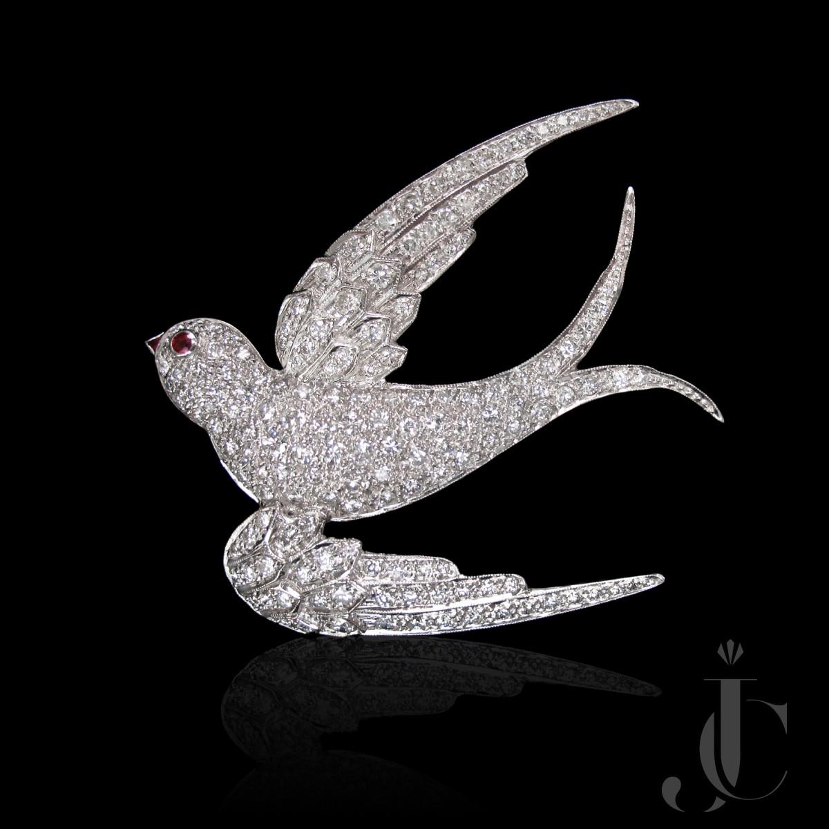 Platinum Diamond Bird Brooch with Ruby accents, circa 1955