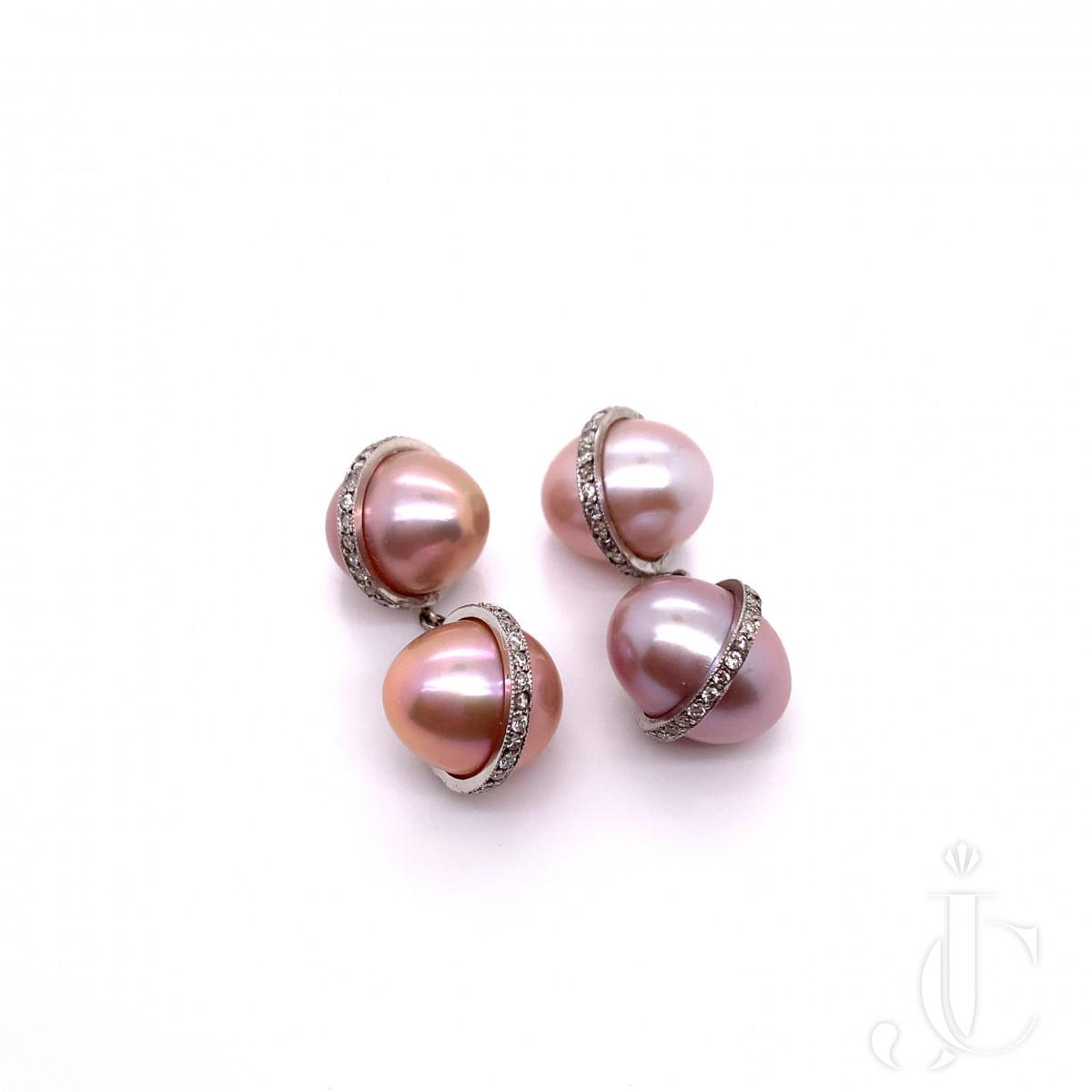 A pair of platinum pearl cufflink