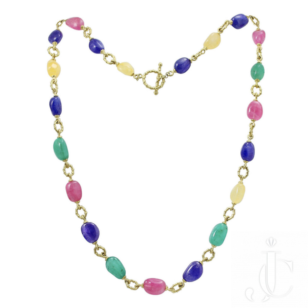 A Multi Gem necklace 31 inches in 18 KT Gold