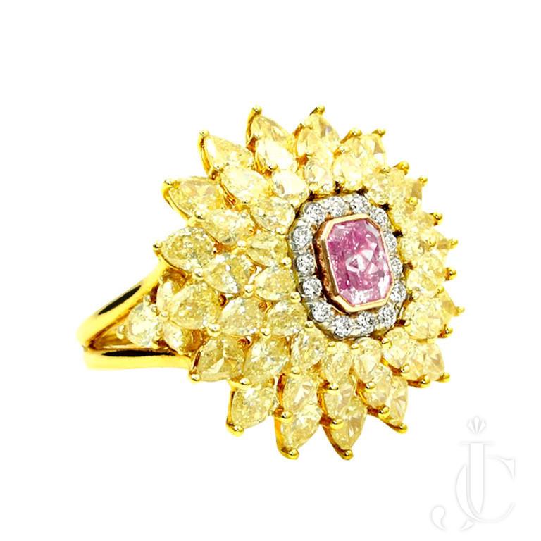 Fancy Intense Pink Diamond Ring Surrounded by yellow Diamonds