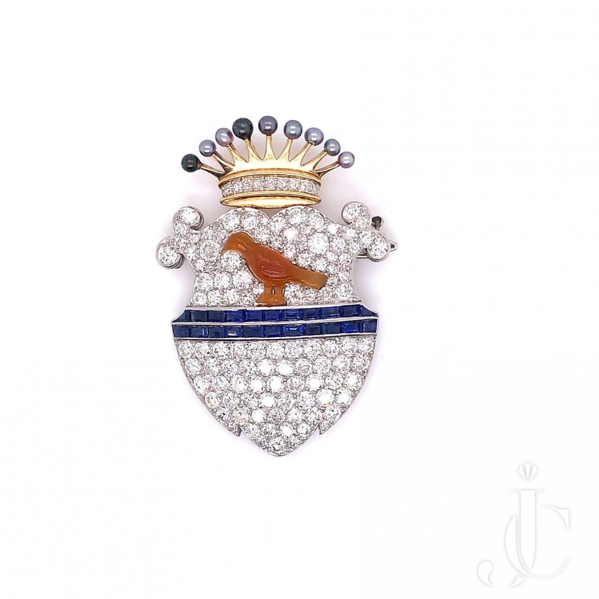 An 18k gold diamond, sapphire bird brooch by Cartier NY 1930s