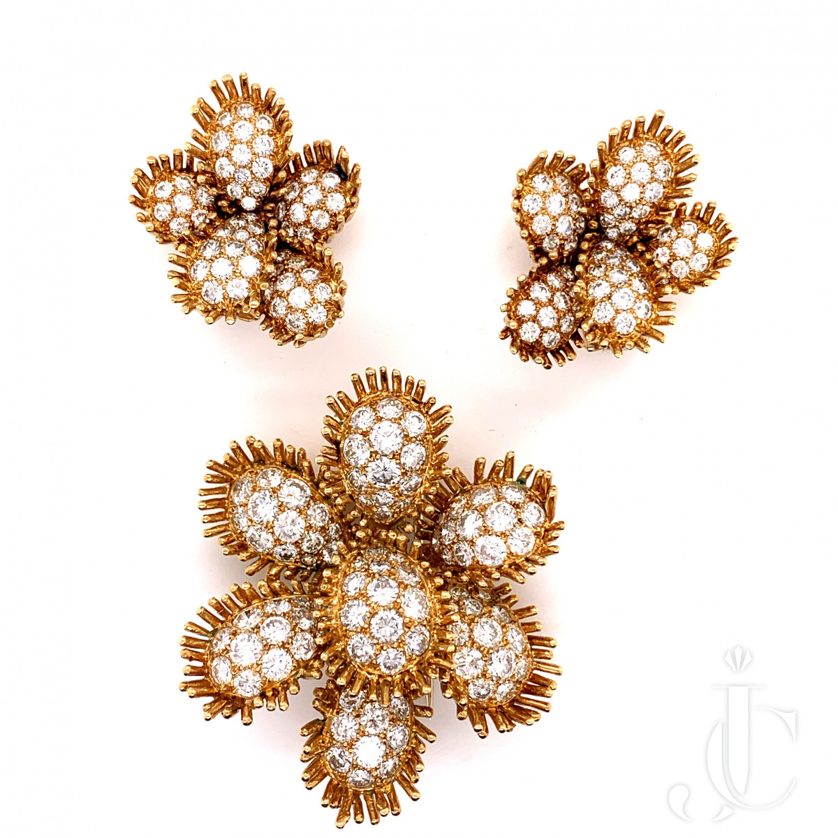 A set of  18k gold diamond cactus earring and brooch by VCA