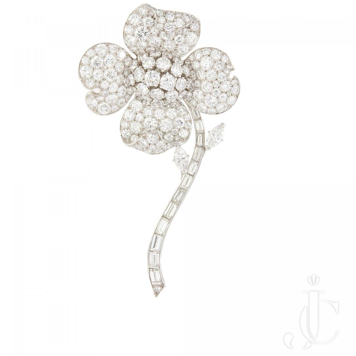 A platinum diamond floral brooch by Van Cleef & Arpels NY
