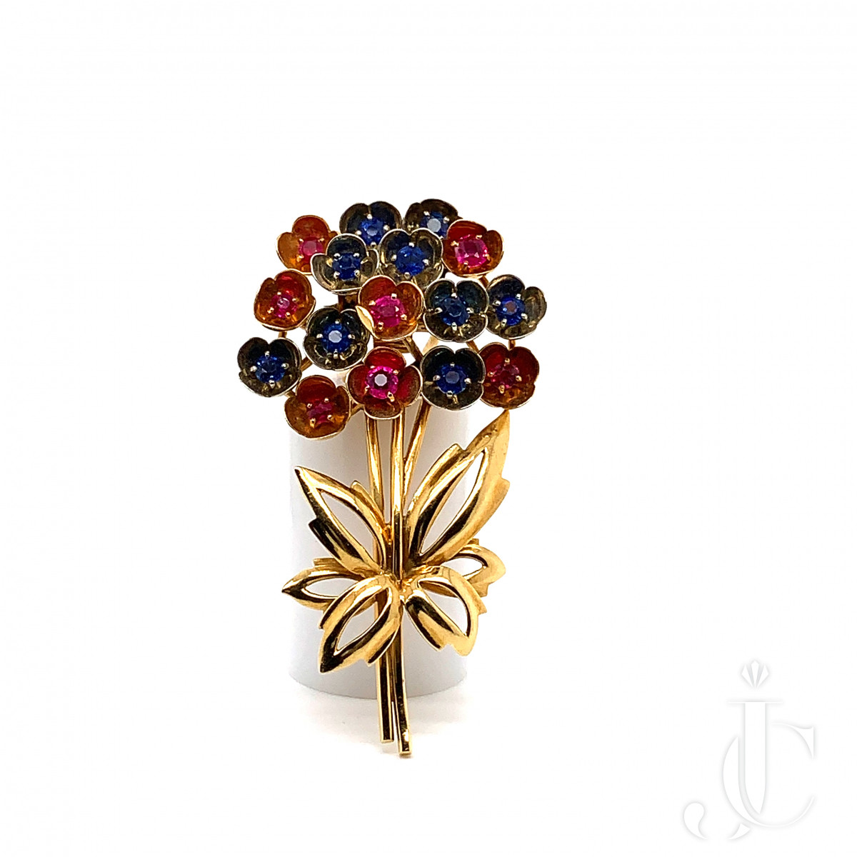 Gold, rubis and sapphire flowers brooch by Cartier
