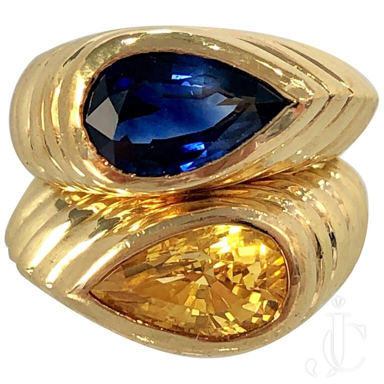 PAIR OF FLUTED GOLD RINGS WITH PEAR SHAPED BLUE And YELLOW SAPPHIRES BY NIVA