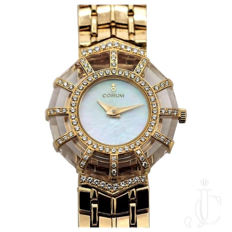 LADIES GOLD CORUM WATCH WITH DIAMOND AND CRYSTAL BEZEL And MOTHER OF PEARL DIAL