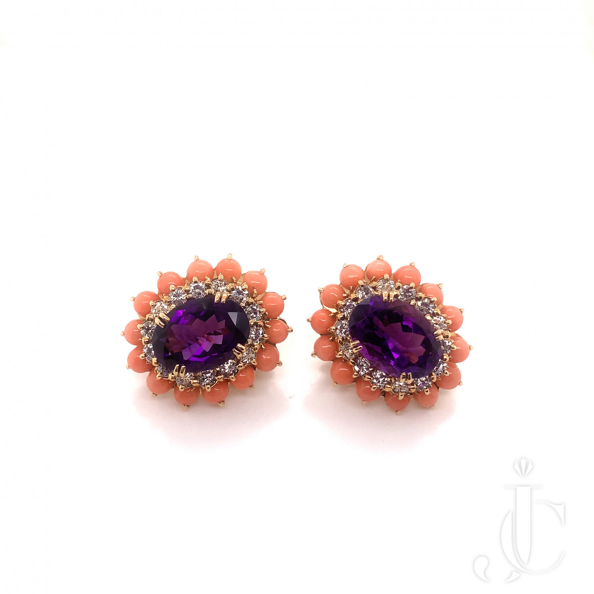 A pair of 18k gold diamond, amethyst and coral earring by Boucheron,