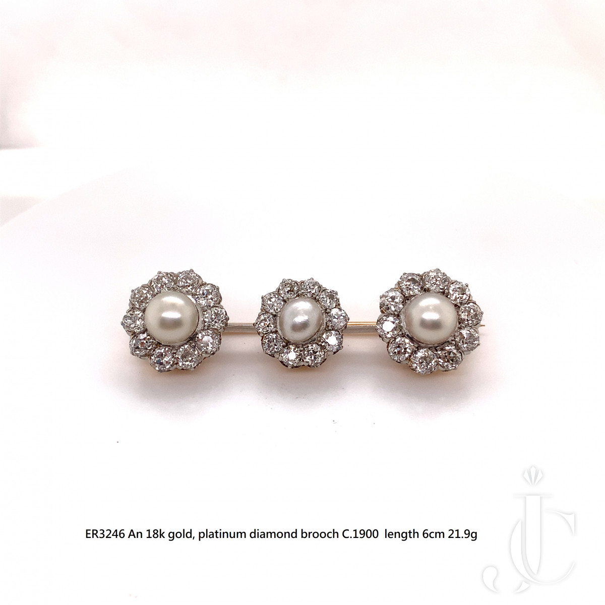 An 18k gold, platinum pearl and diamond brooch