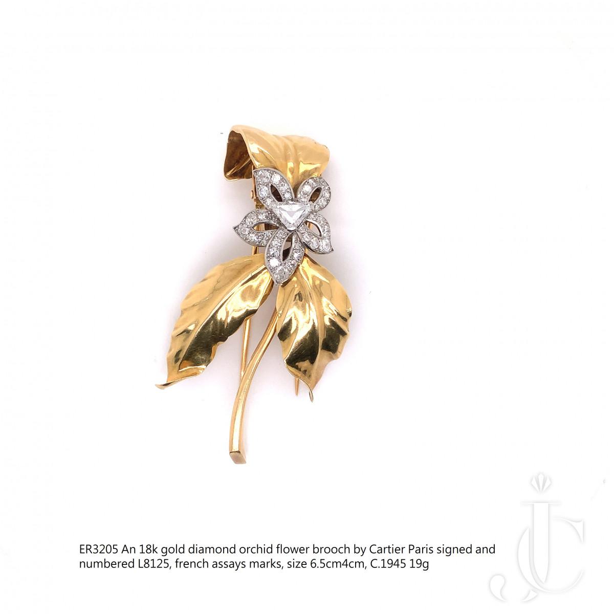An 18k gold diamond orchid flower brooch by Cartier Paris