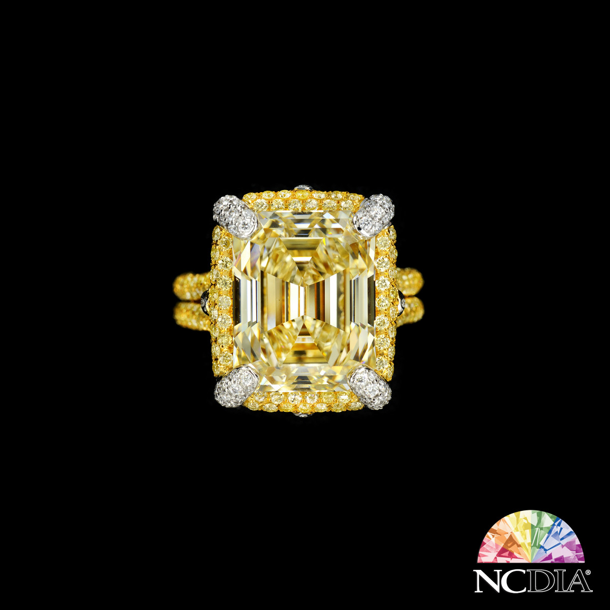 Over 10 cts Emerald cut Fancy Yellow VVS2 Diamond Ring, GIA report ava.