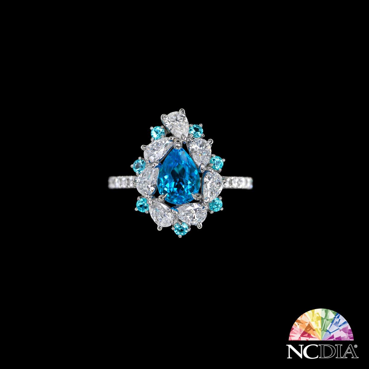 Over 1ct Pear Shape Intensive Greenish Blue Brazilian Paraiba Tourmaline Diamond Ring, AGL cert ava.