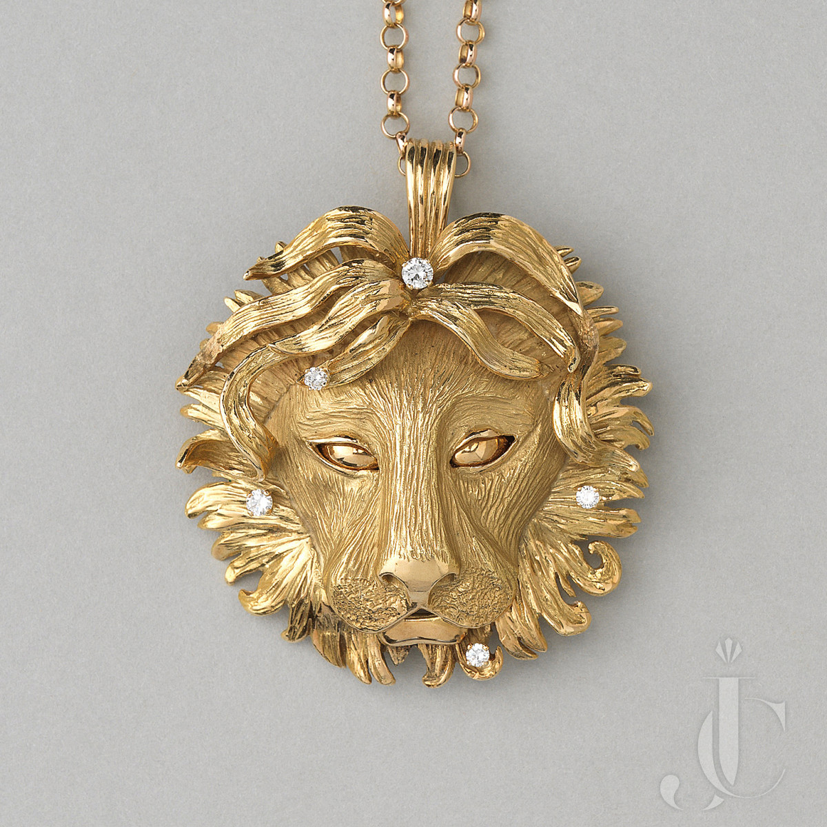 gold and diamond leo pendant