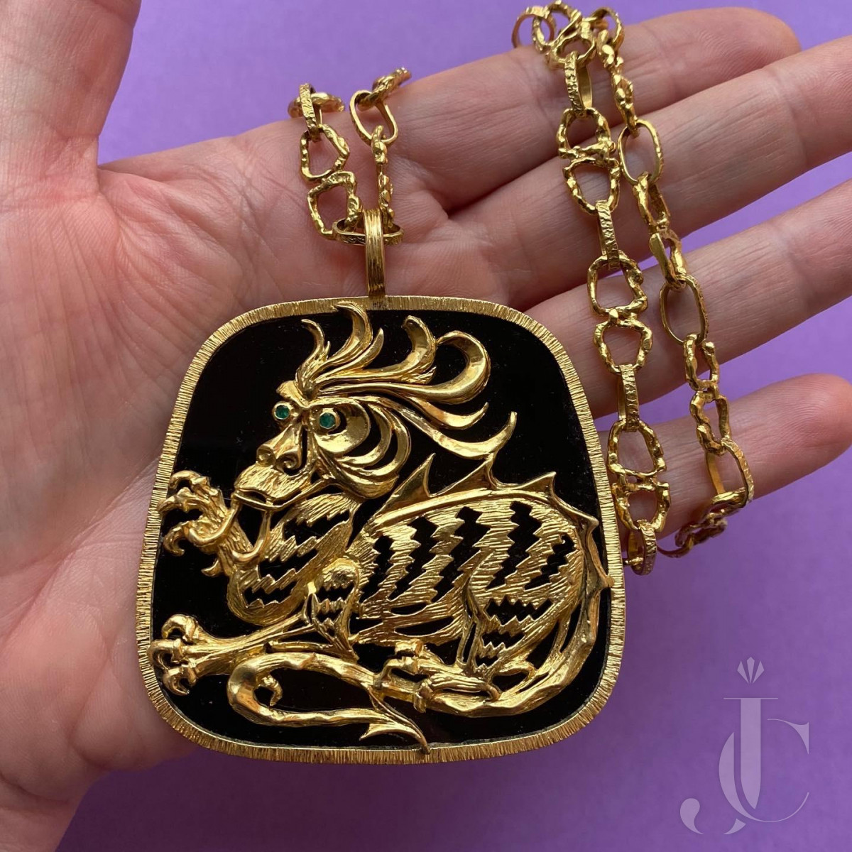 Gold and onyx and emerald dragon pendant and chain