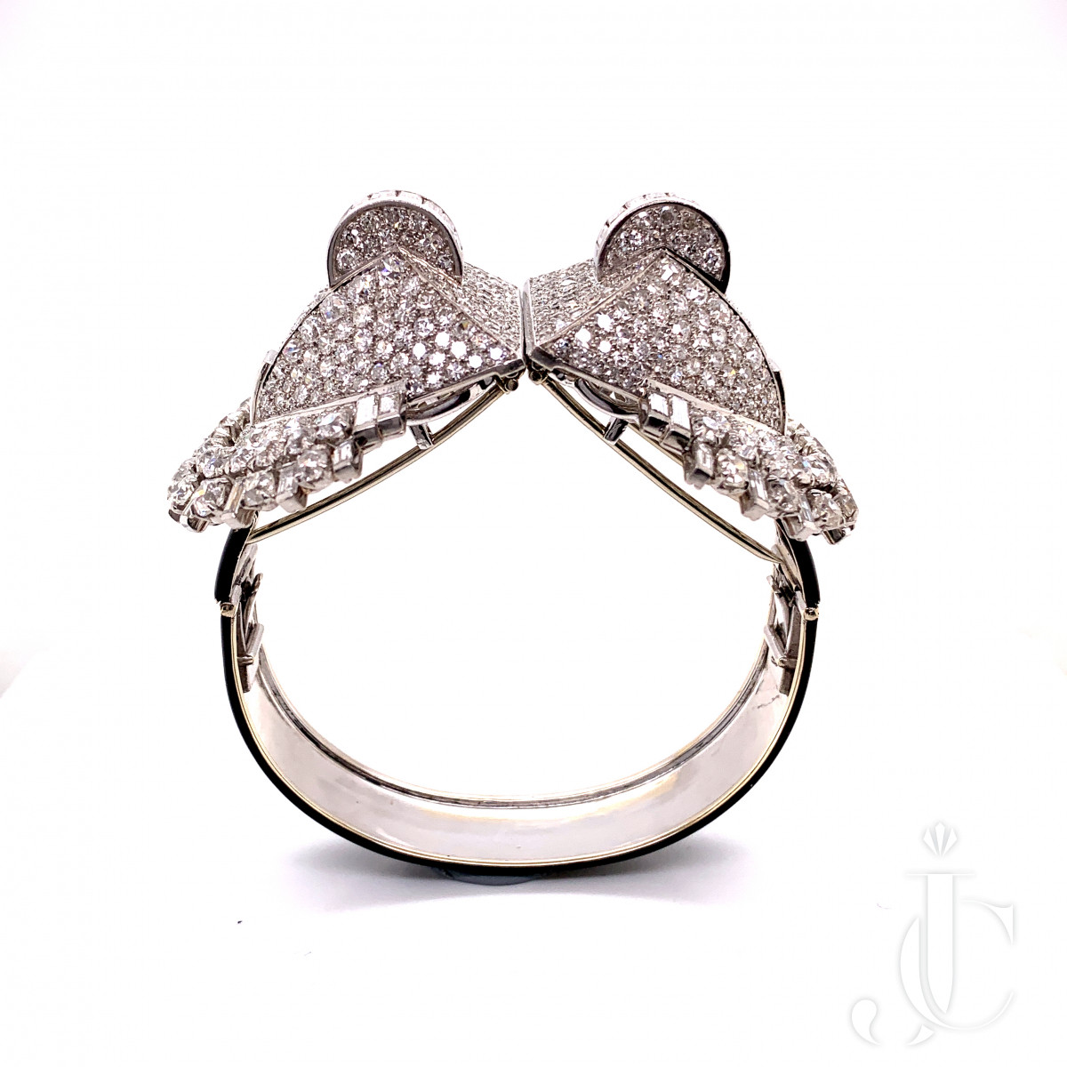 A pair of platinum French clips / bangle with diamond by Mauboussin